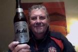 Super smooth guy drinks super dry beer