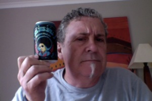 Man with Big almost Afro hair holds a small can