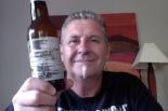 confused man holds Danish belgian ipa fruit beer