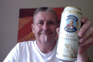 white haired man has a wheat beer
